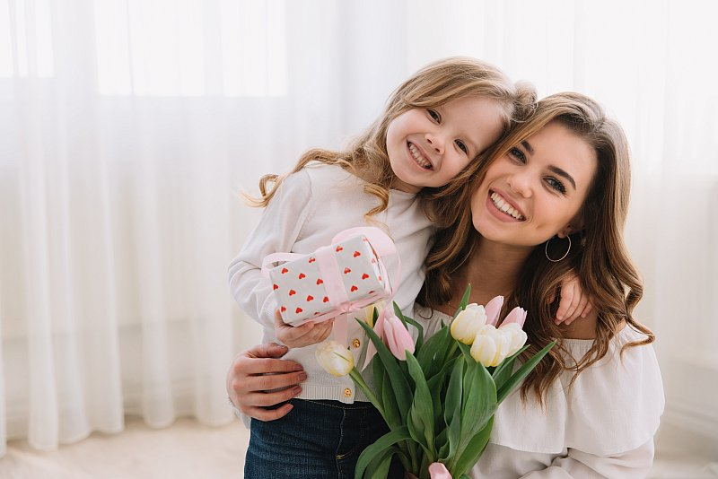 happy-mother-s-day-child-daughter-congratulates-moms-gives-her-flowers-tulips-gift.jpg